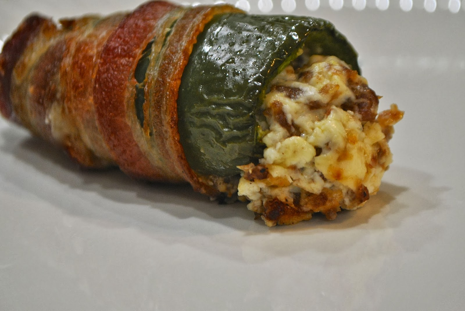 bacon wrapped jalapenos with cream cheese and sausage