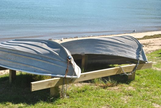 Overturned row boats by the beach
