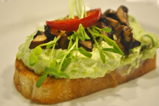ricotta peas ans marinated mushrooms on toasted bread
