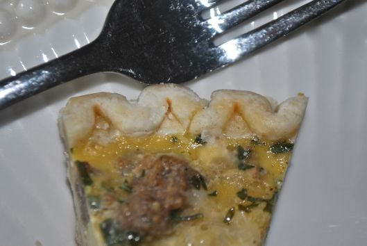 cheese and sausage quiche piece
