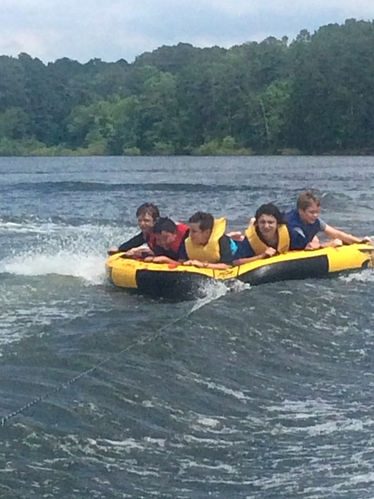 boys tubing on lake De Gray