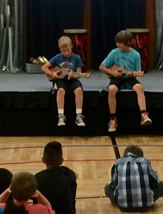 Max and Hud playing ukulele in the final school talent show