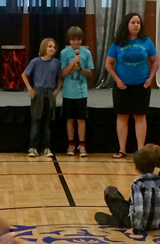 Max leading the Pledge of Allegiance at the final school assembly
