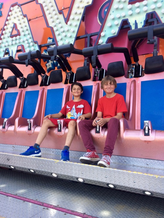 the boys on their first ride at the carnival