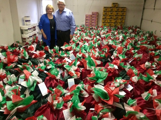 John and Susan Chase-Bakker with bags for homebound seniors