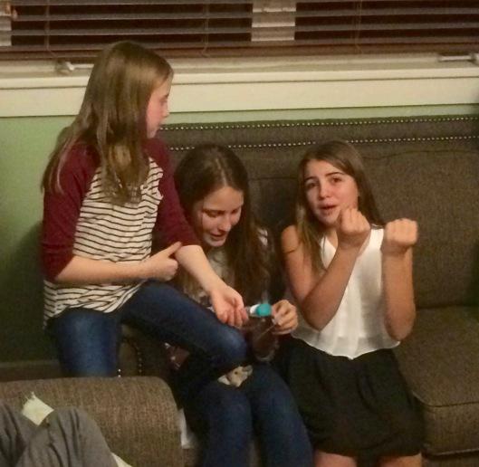 "Elise opening her ""secret santa"" gift"