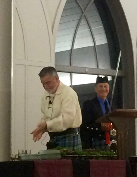 Father Lowell addressing the Haggis